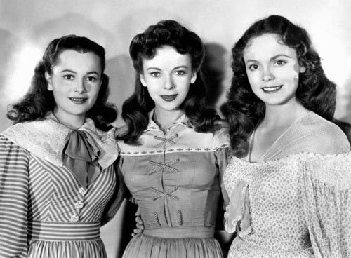 Three sisters, three awful historical costumes - the crisscross stuff? off-the-shoulder? ugh.