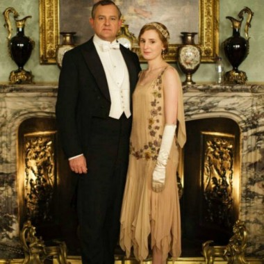 "Lord Grantham & Lady Edith in the infamous ""water bottle"" promo pic (look to the right on the mantle)."